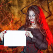 Halloween witch holding sheet of paper — Stock Photo