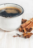 Old cup of coffee and spices — Stock Photo