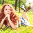 Beautiful young woman lying on the grass — Stock Photo