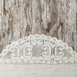 Linen fabric with lace on the old wooden background — Stock Photo