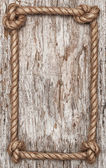 Rope frame and wood background — Stock Photo