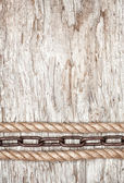 Metal chain and rope on the old wood — Stock Photo