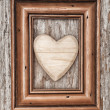 Wooden heart in frame on old wood — Stok Fotoğraf #34081479