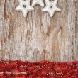 Christmas background with star shapes and chaplet — Stock Photo