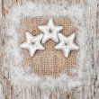 Stock Photo: Star shapes and burlap textile on old wood