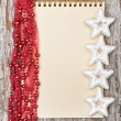 Christmas background with notebook and garland — Stock Photo