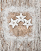 Star shapes and burlap textile on the old wood — ストック写真