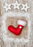 Christmas red sock with snow on burlap textile — Stock Photo