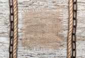 Rustic background with burlap, rope and chain — Stock Photo