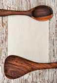 Canvas with wooden utensils — Stock Photo