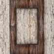 Aged wooden frame on the old wood — Stock Photo