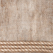 Burlap background with rope — Stock Photo
