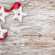 Christmas decoration with red ribbon and silver stars — Stock Photo