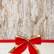 Christmas decoration with red ribbon, bow and canvas — Stock Photo