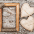 Wooden hearts and frame on the old wood — Stock Photo #34890785