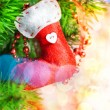 Christmas red sock on fir tree — Stock Photo