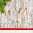 Christmas decoration with red ribbon, canvas and fir branch — Stock Photo