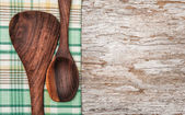 Kitchen utensils on the old wood background — Stock Photo