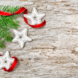 Christmas background with fir branch and ribbon — Stock Photo