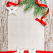 Christmas card with red ribbon, stars and fir branch — Stock Photo