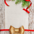 Christmas card with red ribbon, bow and fir branch — Stockfoto