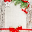 Christmas card with red ribbon, star and fir branch — Stock Photo