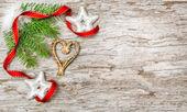 Vánoční pozadí s jedle větev a stuha — Stock fotografie