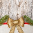 Christmas card with bow, ribbon and fir branches — Stock Photo