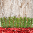 Christmas decoration with red garland, canvas and fir branch — Stock Photo