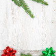 Christmas decoration with silver ribbon, canvas and fir branch — Stock fotografie