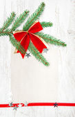 Christmas card with canvas, stars and fir branch — Stock Photo