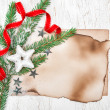 Christmas card with aged paper, stars and fir branches — Stockfoto #35731679