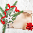 Christmas card with aged paper, stars and fir branches — Stockfoto