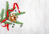 Christmas decoration with fir branch and red ribbon — Stock Photo