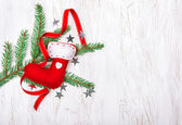 Christmas decoration with fir branch and red sock — Stock Photo