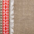 Burlap background bordered by country cloth — Stock Photo