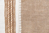 Burlap background with linen cloth and rope — Stock Photo