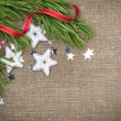 Christmas decoration with fir branch, stars and red ribbon on bu — Stock Photo