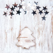 Christmas fir-tree made of birch bark with stars — Stock Photo