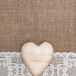 Stock Photo: Burlap background with lacy cloth and wooden heart
