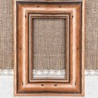 Aged wooden frame on the burlap — Stock Photo