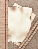 Aged paper with rope on sacking background — Stok fotoğraf