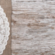 Stock Photo: Old wood bordered by burlap and lacy cloth
