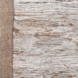 Old wood bordered by burlap — Stockfoto