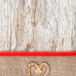 Holiday decoration with straw heart and burlap — Zdjęcie stockowe