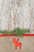 Christmas decoration with red deer and burlap — Stock Photo