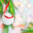 Christmas ball and red ribbon — Stock Photo