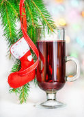 Christmas mulled wine and red sock on fir branch — Stock Photo