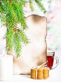 Christmas card with tea and cookies — Stock Photo