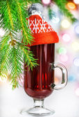 Christmas mulled wine in the glass with red hat — Stock Photo